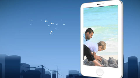 Smartphone showing a family building a sandcastle Animation
