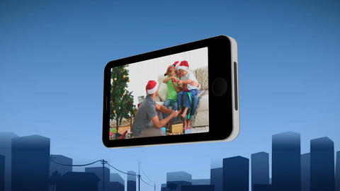 Smartphone showing a family celebrating Christmas Stock Video Footage