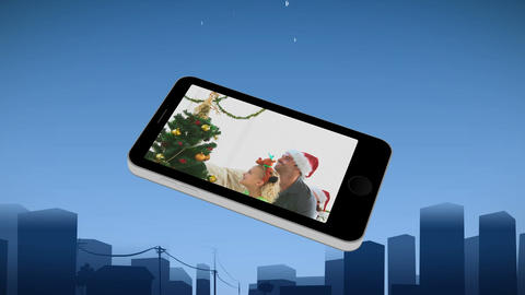 Smartphone showing a family during Christmas Animation