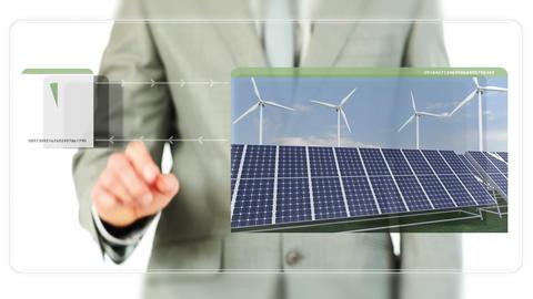 Businessman dragging videos about renewable energi Footage