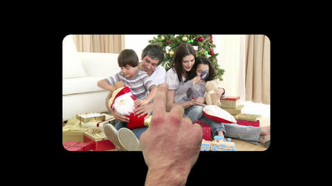 Finger activating and scrolling through christmas Stock Video Footage