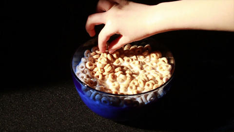 0135 Eating Cereal with Spoon Stock Video Footage