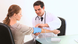 A doctor checking his patient blood pressure Stock Video Footage