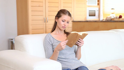 Woman reads her book as a man covers her eyes Stock Video Footage