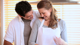 A couple stand in the kitchen Stock Video Footage