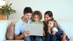 Family using a laptop together Footage
