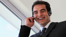 Businessman wearing headset while laughing Stock Video Footage