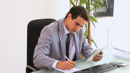 Businessman working with a tablet computer Stock Video Footage