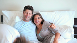 Smiling couple in their bed Footage
