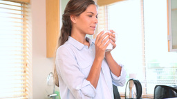 Woman drinking a coffee Stock Video Footage