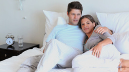 Couple lying on their bed Stock Video Footage