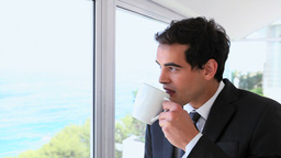 Businessman drinking from a mug Stock Video Footage