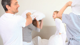 Family having a pillow fight Live Action