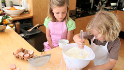 Boy stirring eggs with flour Stock Video Footage