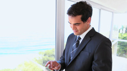 Man in suit using a tablet computer Stock Video Footage