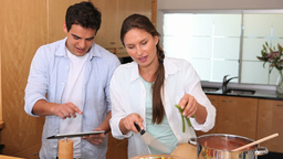 Woman cooking with her husband Stock Video Footage