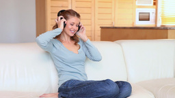 Young woman listening to music with headphones Stock Video Footage