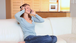 Young woman listening to music with headphones Footage