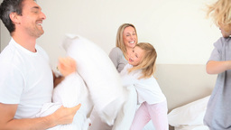 Family having a pillow fight against the father Stock Video Footage