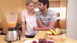 Lady giving a smoothie to her boyfriend Stock Video Footage