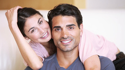 Couple embracing while sitting Footage