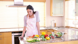 Young woman preparing a salad Stock Video Footage