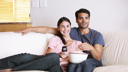 Happy couple watching the television Stock Video Footage
