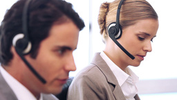 Call centre agent talking while using her headset Footage