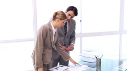 Business people working together on charts Stock Video Footage