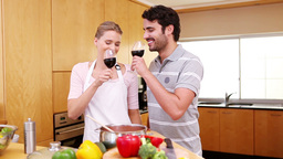 Couple clinking their glasses of red wine Live Action
