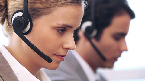 Call centre agent working with a headset Stock Video Footage