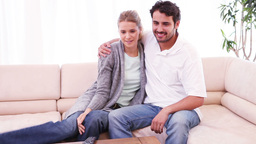Smiling couple watching the television Footage