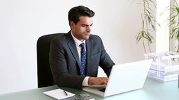 Businessman seriously working Footage