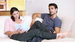Young couple sitting on their couch Stock Video Footage