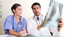 Two doctors looking at an xray Stock Video Footage