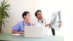 Doctors looking at an xray Footage
