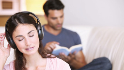 Young relaxed woman listening to music Footage