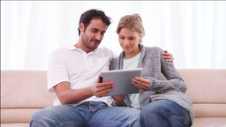 Smiling couple using a tablet computer Stock Video Footage