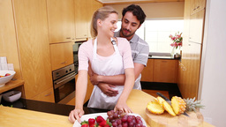 Smiling couple eating fruits Footage