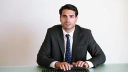 Businessman typing on a keyboard Footage
