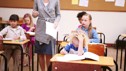 Teacher handing out papers Stock Video Footage