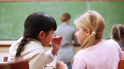 Pupils whispering secrets Stock Video Footage