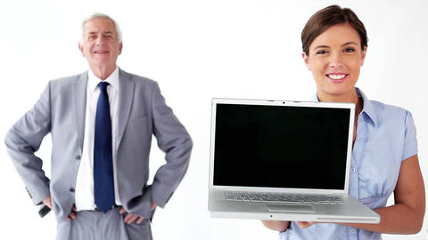 Smiling employee holding a laptop Footage