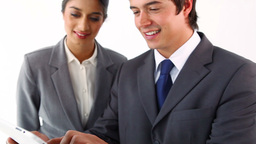 Smiling business people using a tablet pc Footage
