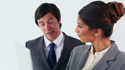 Business people talking in front of a laptop Stock Video Footage
