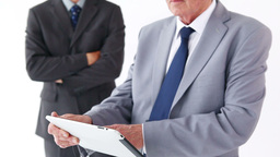 Businessman using a tablet pc with a colleague Stock Video Footage