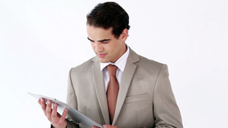 Serious businessman using a tablet pc Footage