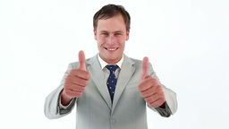 Businessman placing his thumbs up Footage