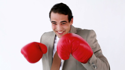 Smiling executive using boxing gloves Footage