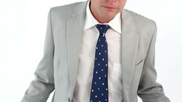 Sad businessman showing his empty pockets Footage